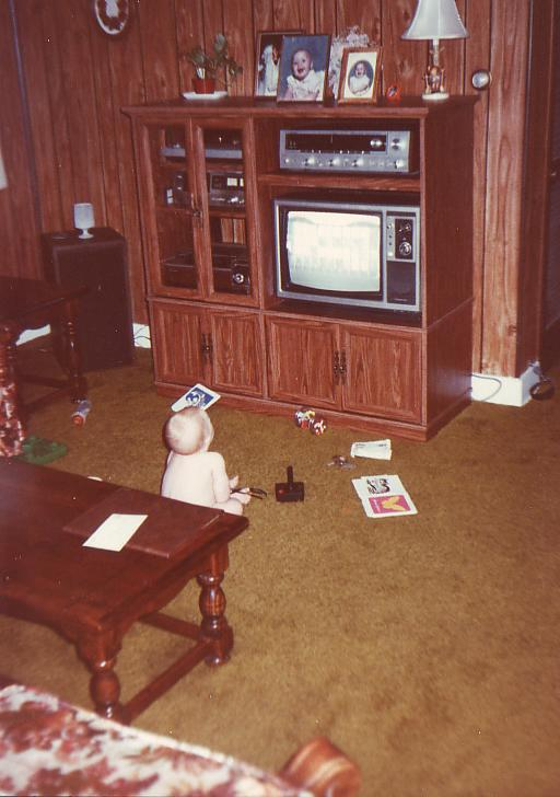 Jillian watching Wheel of Fortune as a baby